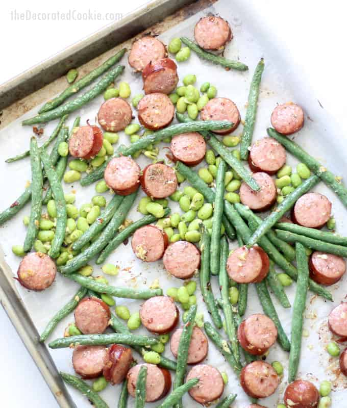 This kielbasa and green beans sheet pan dinner with edamame/soy beans is a delicious, low-carb, easy weeknight dinner idea that takes less than thirty minutes to make. Low-carb, gluten-free, keto dinner ideas. Video recipe included.