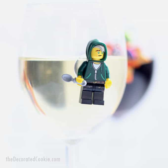 Make Lego Minifigures wine charms. This easy, DIY wine charms craft is a great conversation starter for your next party. Video how-tos included. #Lego #Minifigure #party #winecharms #DIY #crafts #winemarkers