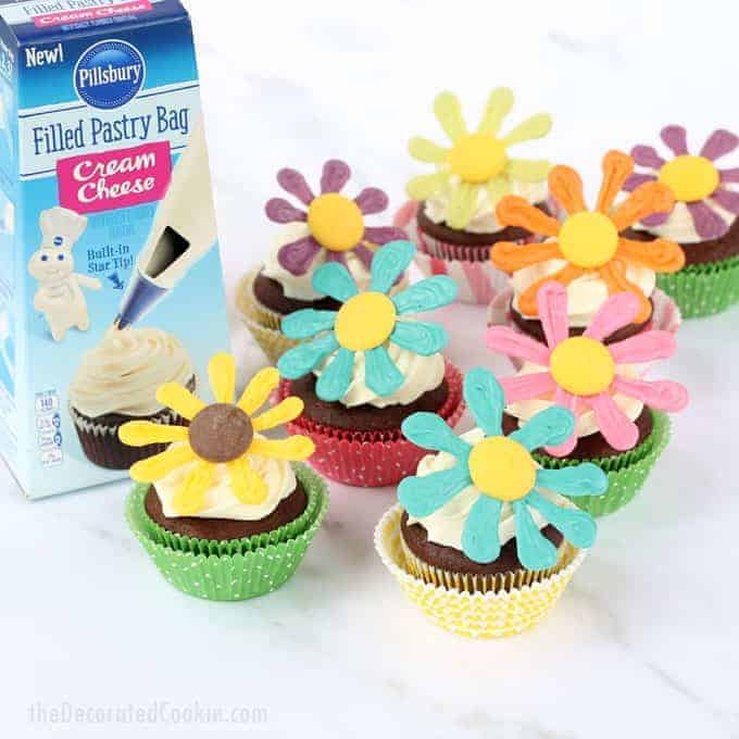 Celebrate summer with these gorgeous flower cupcakes: These colorful summer flower cupcakes are a cinch to make with the new Pillsbury™ Filled Pastry Bags (in Chocolate, Vanilla, and Cream Cheese) from Walmart. Chocolate cupcakes, swirled Cream Cheese frosting, and bright candy flower cupcake toppers. #Sponsored #ad #FlowerCupcakes #SummerCupcakes #ChocolateCupcakes @Pillsbury @Walmart