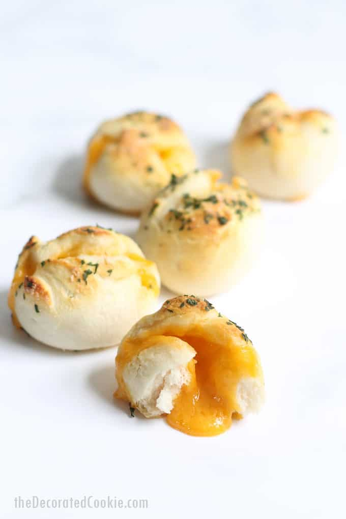 "Cheese bombs: Wrap cheese in refrigerated biscuits and bake to make these ""grilled cheese"" bombs for an EASY lunch or appetizer idea. #Cheese #EasyAppetizer #2ingredient #refrigeratedbiscuts"