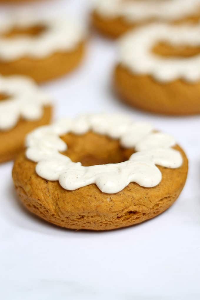 These 2-ingredient pumpkin donuts, baked, not fried, are so easy to make with cake mix and pumpkin puree. A perfect treat for fall and Halloween. #pumpkin #donuts #doughnuts #fall #Halloweendesserts #falldesserts #pumpkindonuts #doughnuts #2ingredient
