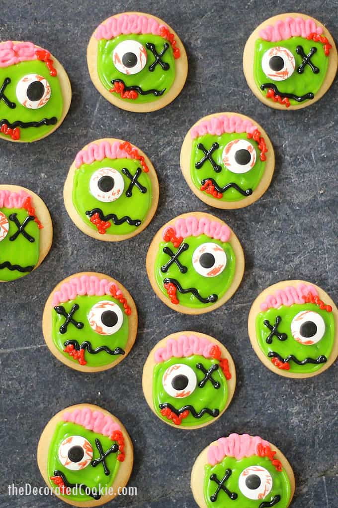 ZOMBIE COOKIES! Mini zombie cookies are the perfect Halloween treat or Halloween party favor and dessert. Easy to decorate, video recipe. #halloween #partyfood #cookiedecorating #zombies #zombiecookies