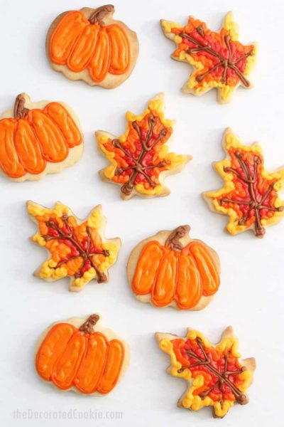 These pumpkin and leaf fall cookies are a fun food craft for autumn, Thanksgiving, school bake sales, and fall fests. #cookiedecorating #fallcookies #Thanksgiving #desserts #partyfavors #bakesale #pumpkins #leaf