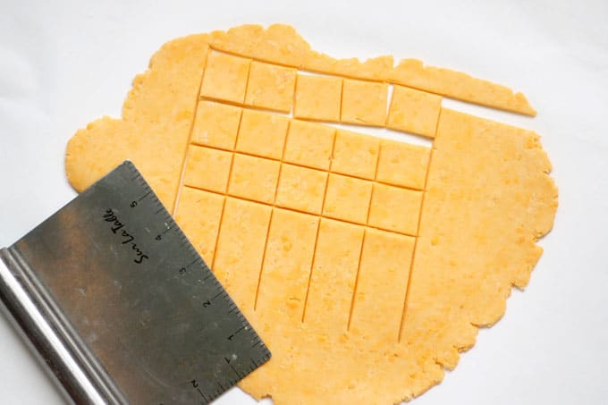 Homemade Cheez-its, filled with real cheddar cheese and baked to a crisp, are even better than the store-bought crackers. #homemade #crackers #storebought #copycat #snacks #cheezits #homemadecheezits #cheese