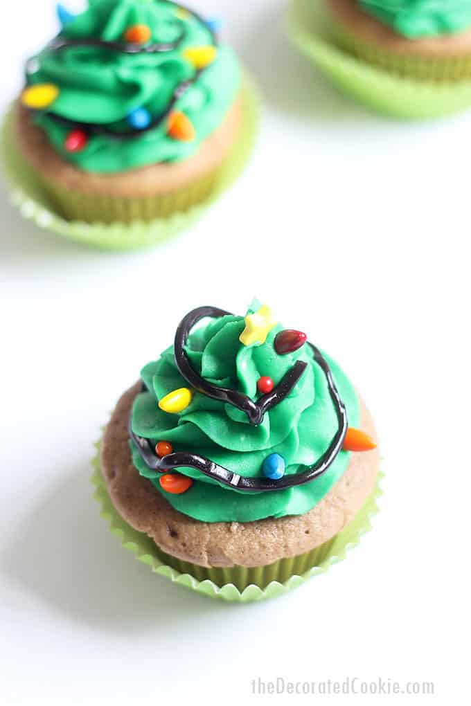 CHRISTMAS TREE CUPCAKES -- topped with green frosting and sprinkles are an easy Christmas cupcake idea using Wilton icing decorations.