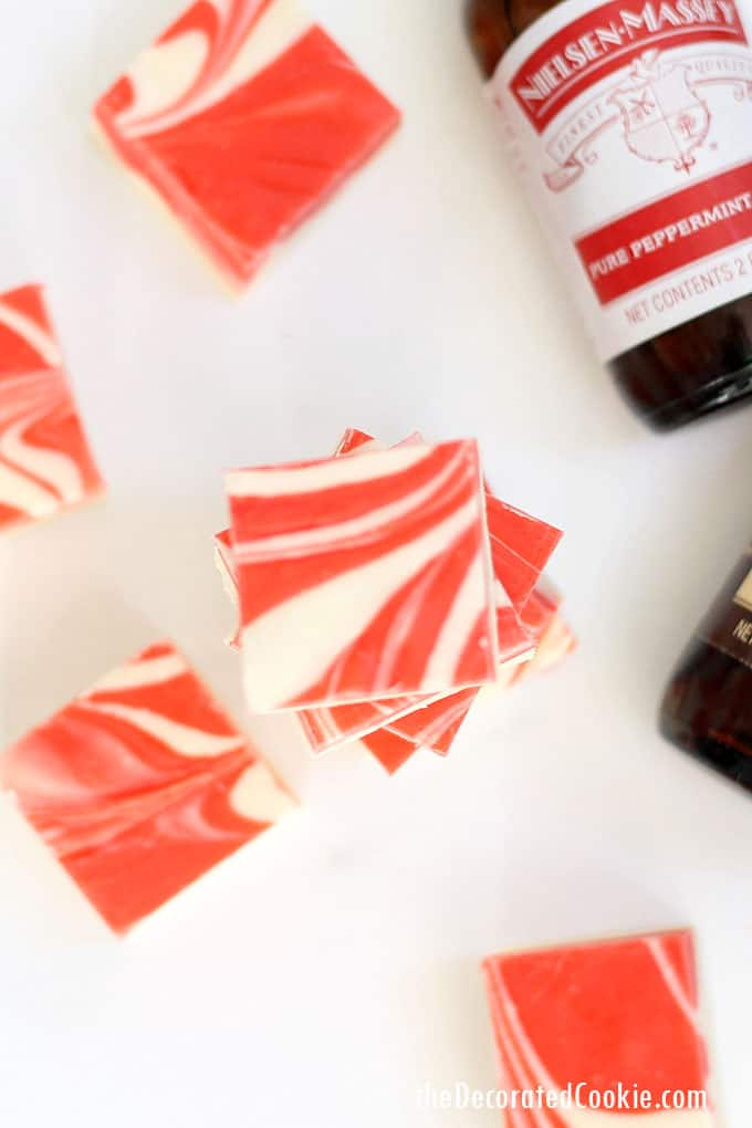 This gorgeous, swirled PEPPERMINT FUDGE recipe is so easy, but makes a beautiful holiday gift. Flavored with Nielsen-Massey Pure Vanilla Extract and Pure Peppermint Extract. #NielsenMasseyPartner #ad #peppermint #peppermintfudge #easyfudge #fudgerecipe #homemade #giftidea #candycane