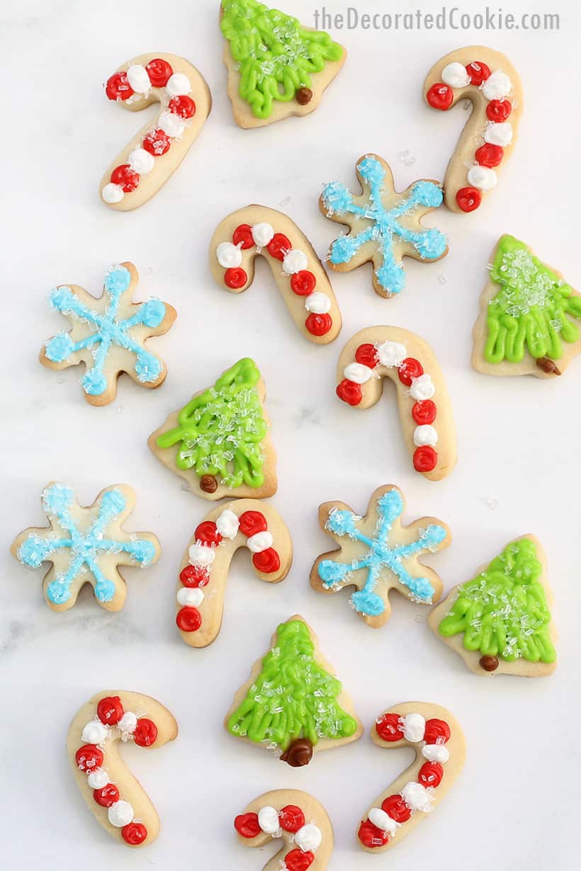 mini decorated Christmas cookies with royal icing and sprinkles
