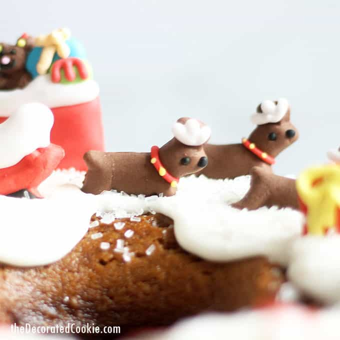 Easy Christmas dessert idea! GINGERBREAD BUNDT CAKE with icing decorated with Santa, reindeer, presents, and as a gingerbread house for Christmas. #Christmas #christmasdessserts #gingerbreadbundtcake #gingerbreadrecipe #gingerbreadcake #ChristmasCake