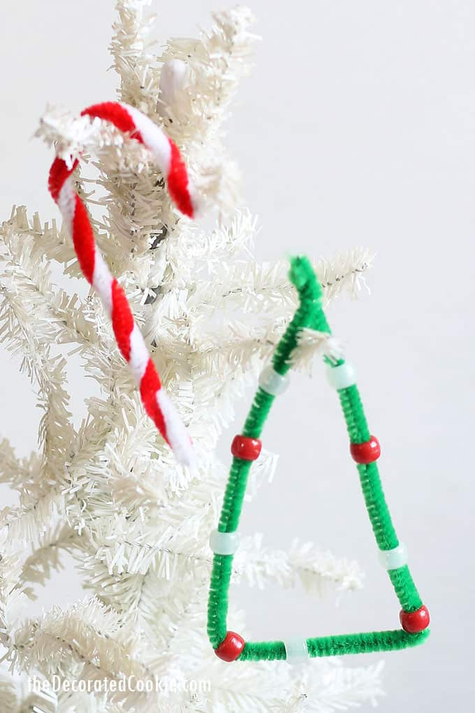 CHRISTMAS ORNAMENT CRAFTS: Easy pipe cleaner ornaments and pom pom baubles that kids can make! Great classroom Christmas crafts for kids. #christmas #ChristmasCrafts #kidscrafts #Christmascraftsforkids #diyornaments #pipecleanerornaments #christmastree #candycane