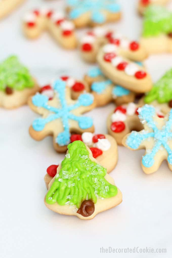 These sparkly MINI CHRISTMAS COOKIES are topped with sprinkles and easy to decorate. Package in