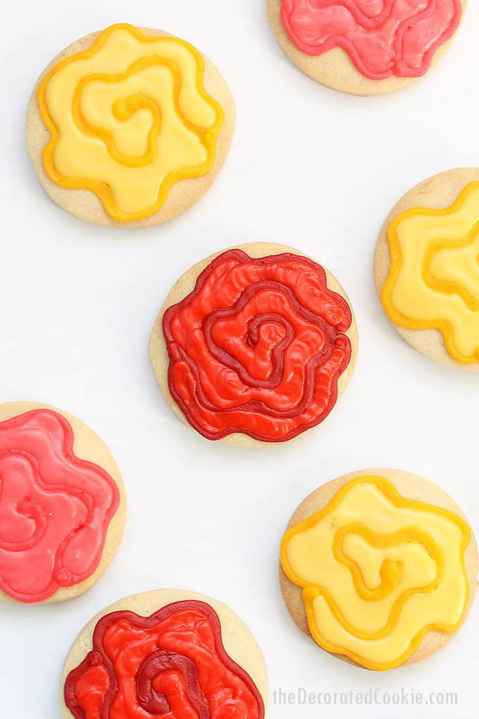EASY ROSE COOKIES decorated with two colors of royal icing on circle cookies. Flower cookies for birthdays, Mother's Day, Easter, Valentine's Day and more.