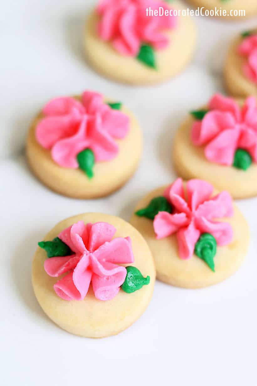 Mini rose cookies decorating with buttercream frosting for Valentine's Day