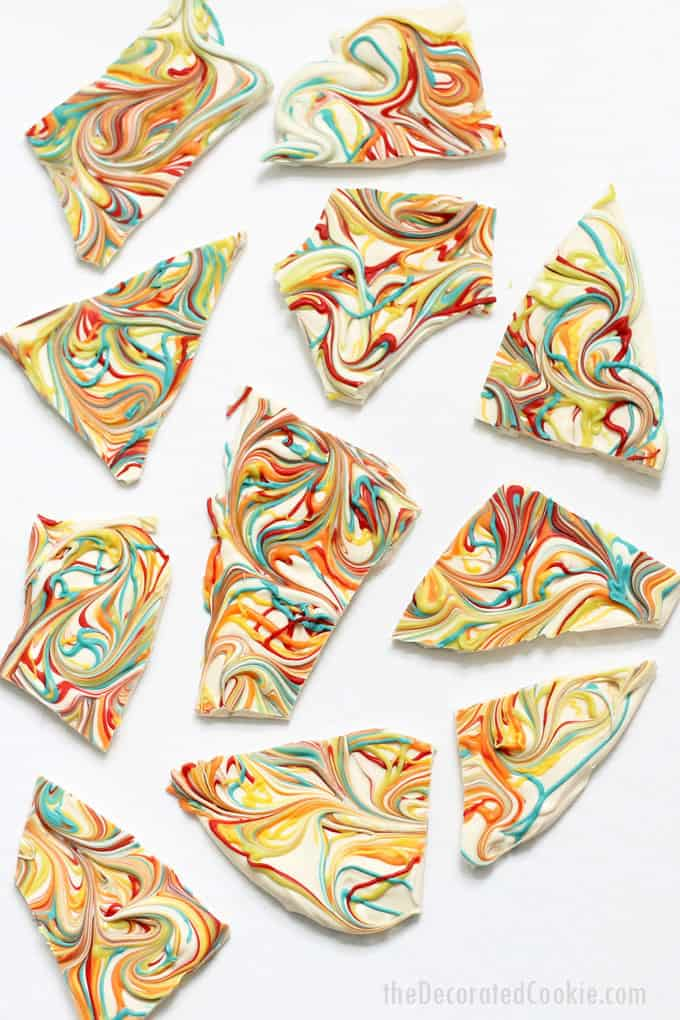 RAINBOW CHOCOLATE BARK-- swirls of colorful candy in white chocolate for a delicious ,easy, no-bake dessert for St. Patrick's Day or a rainbow party.