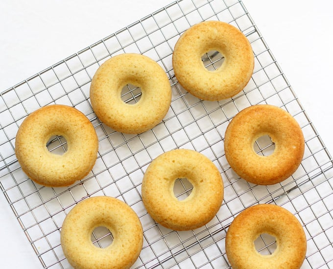 EASY BAKED DONUT RECIPE -- One bowl, quick vanilla baked donuts. Top with donut glaze and sprinkles for a delicious treat or dessert.