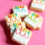 MINI BIRTHDAY CAKE COOKIES -- A cute decorated cookie idea for a homemade birthday gift idea or birthday party favors. Royal icing and square cookies.