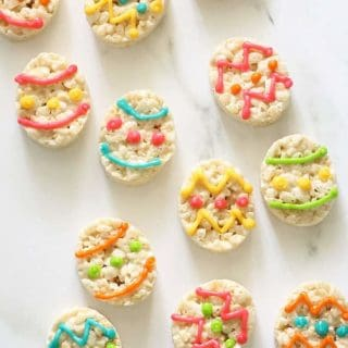 EASTER EGG RICE KRISPIE TREATS with white chocolate -- Easy, no-bake Easter dessert. Cut out oval cereal treats and decorate with royal icing.