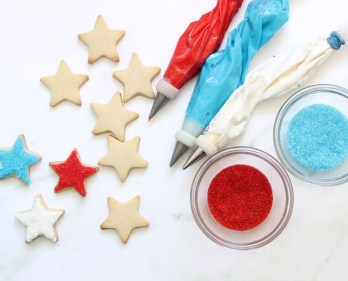 cookies, icing bags, and sprinkles to make 4th of July star cookies