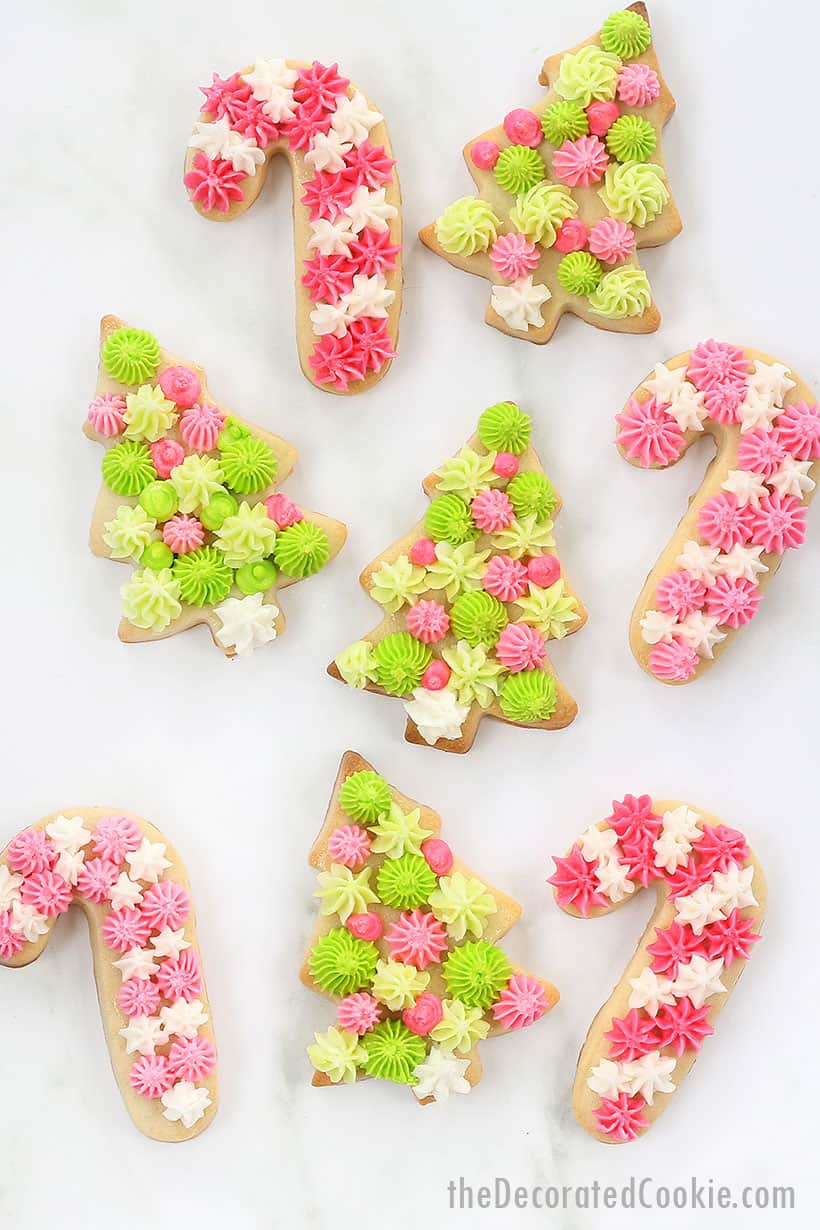 Christmas cookies with piped frosting in pastel pinks and greens