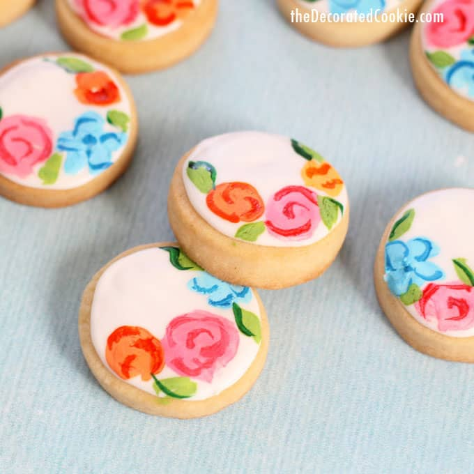 painted flower cookies on blue background