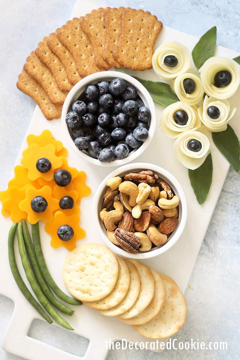 cheese flowers on a cheese board with snacks
