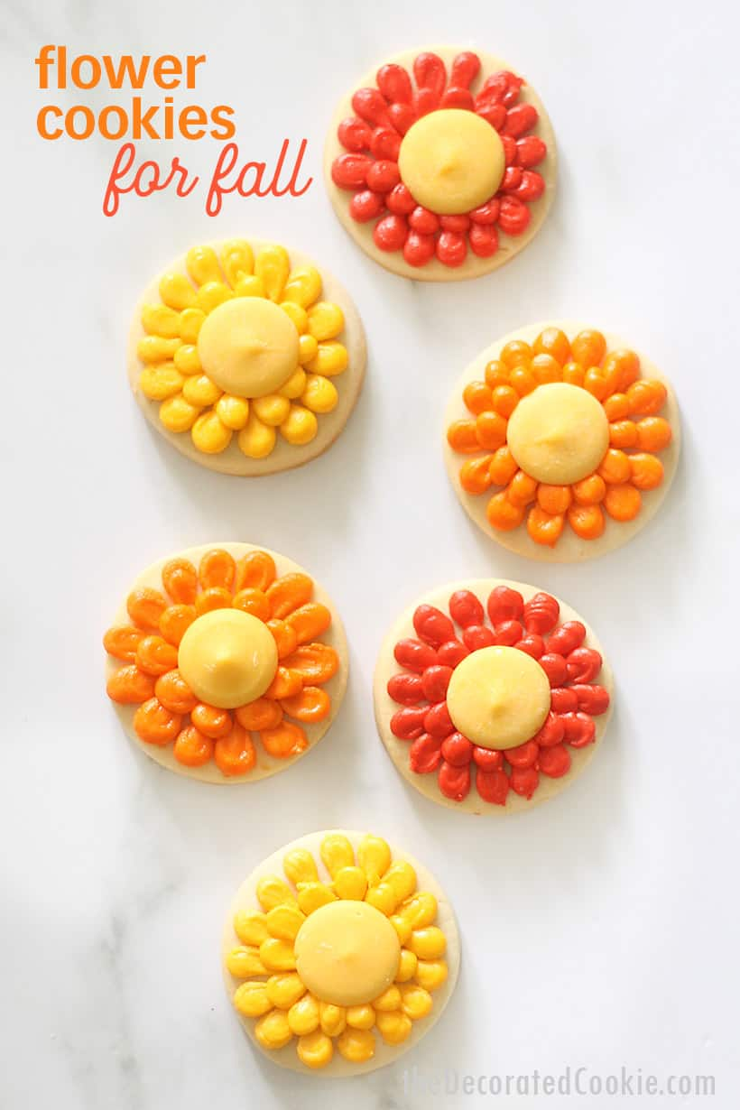 piped fall flower cookies in orange and yellow