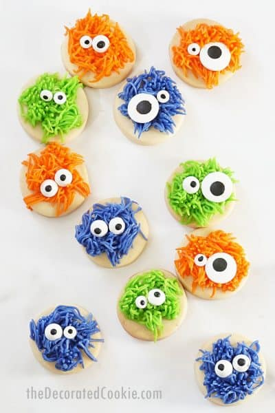 fuzzy monster Halloween cookies made with frosting on bite-size circle cookies