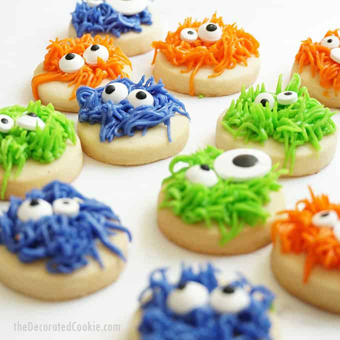 fuzzy monster halloween cookies with white background