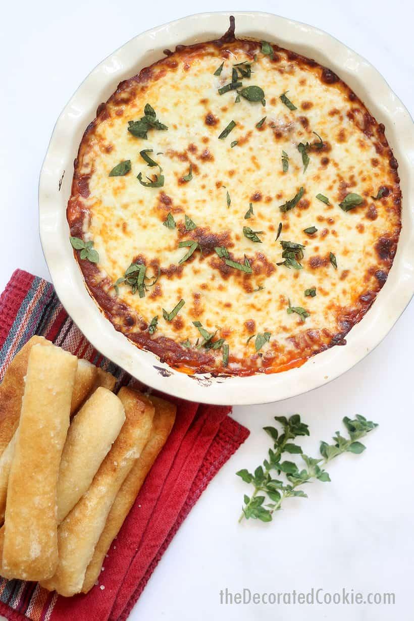 copycat Olive Garden lasagna dip with breadsticks