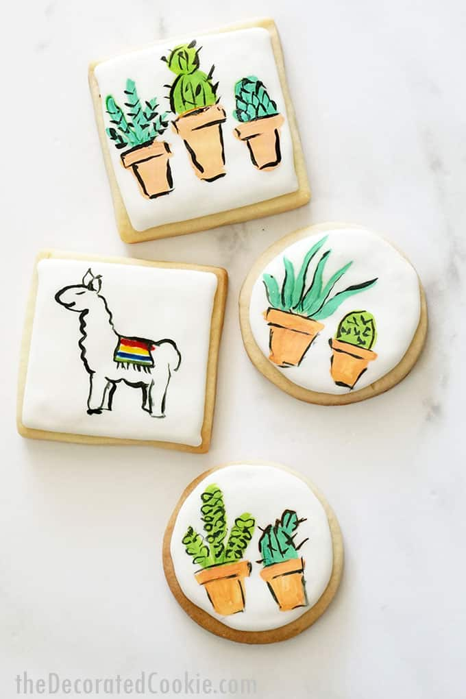 overhead view of llama and succulent painted cookies