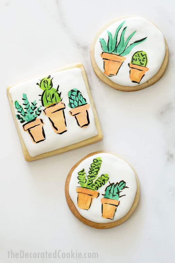 overhead view of painted succulent cookies