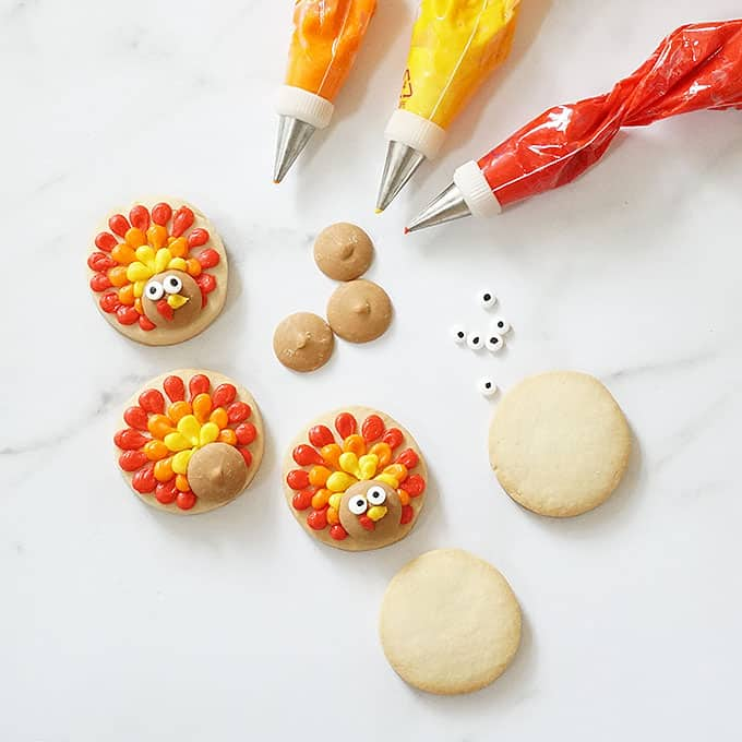 overhead image of decorating turkey cookies