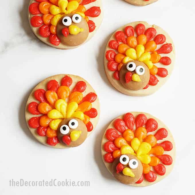 PIPED TURKEY COOKIES -- Decorate cute, simple cookie circles with frosting for a fun and easy Thanksgiving desssert idea.