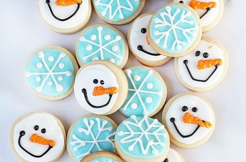 mini snowman and snowflake decorated cookies for winter and Christmas