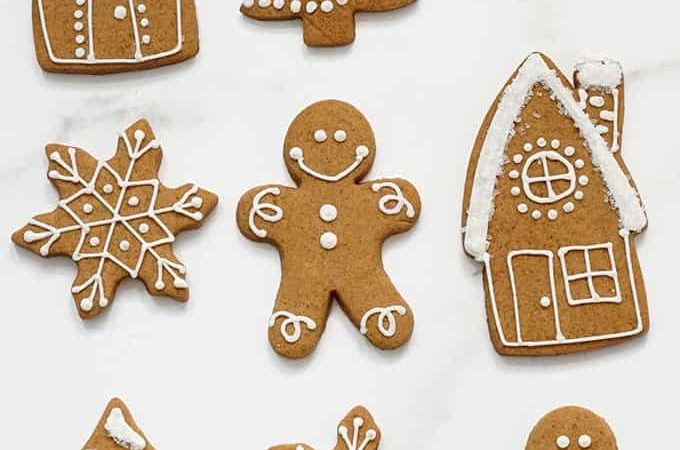 overhead image of cut-out gingerbread cookies