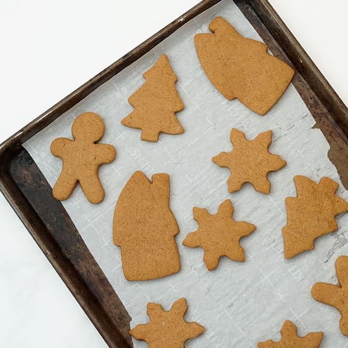 cut-out gingerbread cookies on baking tray