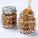 edible gingerbread cookie dough in little mason jars painted as gingerbread men