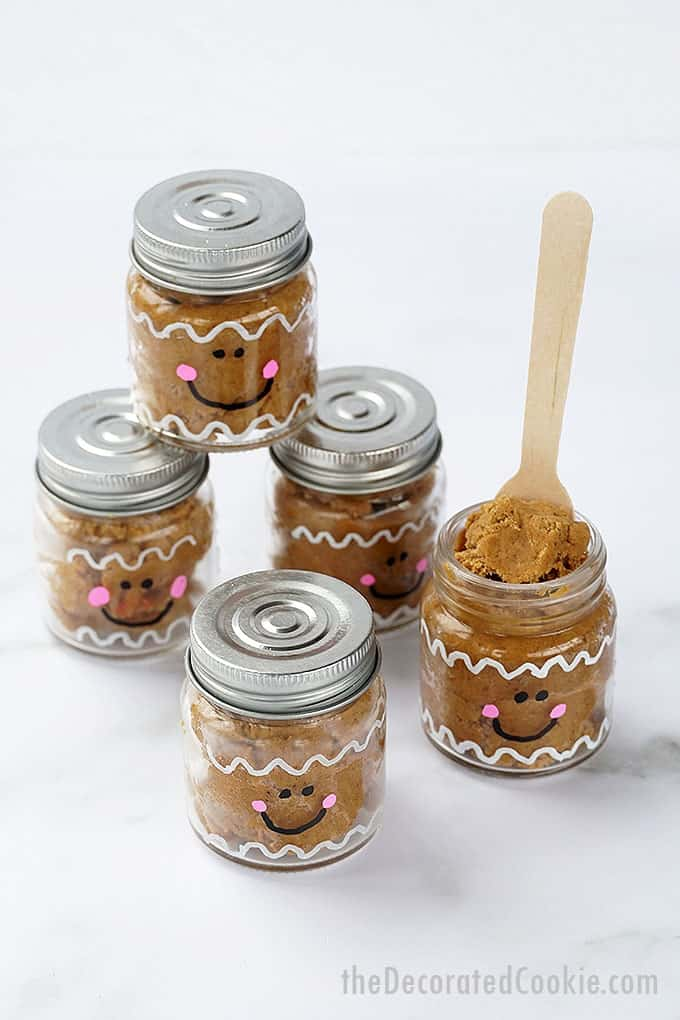 edible gingerbread cookie dough in little mason jars painted as gingerbread men
