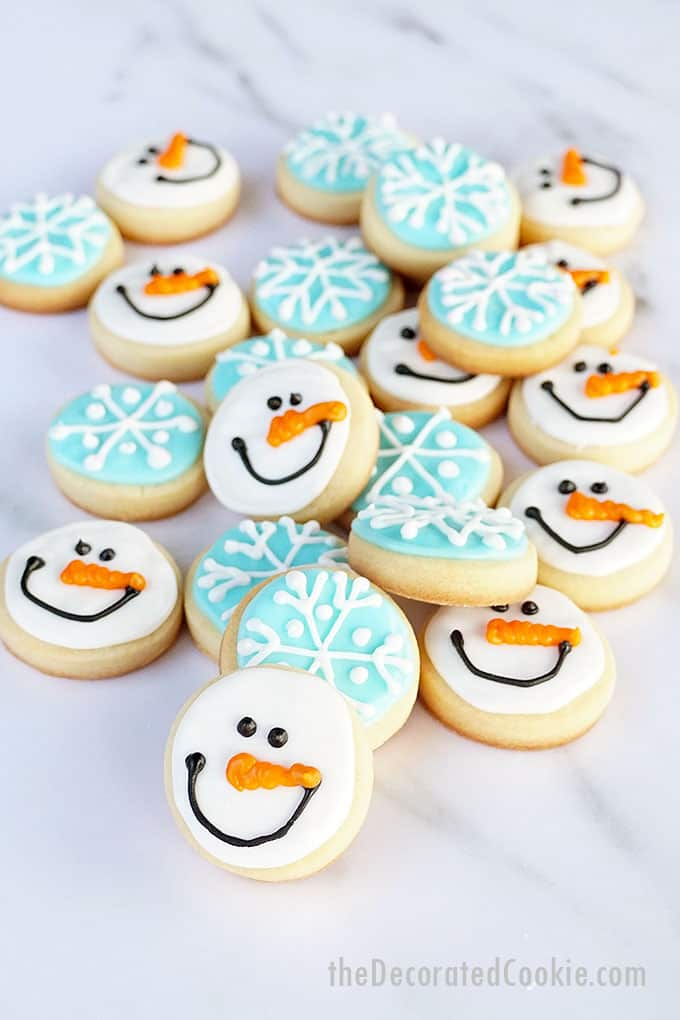 overhead view of snowman and snowflake cookies