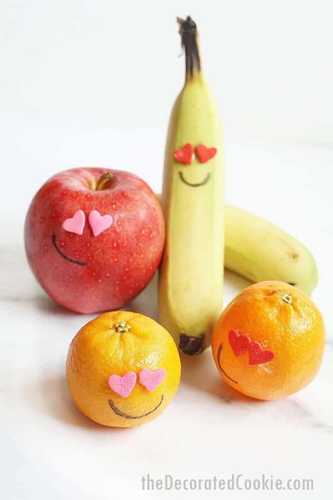 a collection of fruit with heart sprinkle eyes for Valentine's Day
