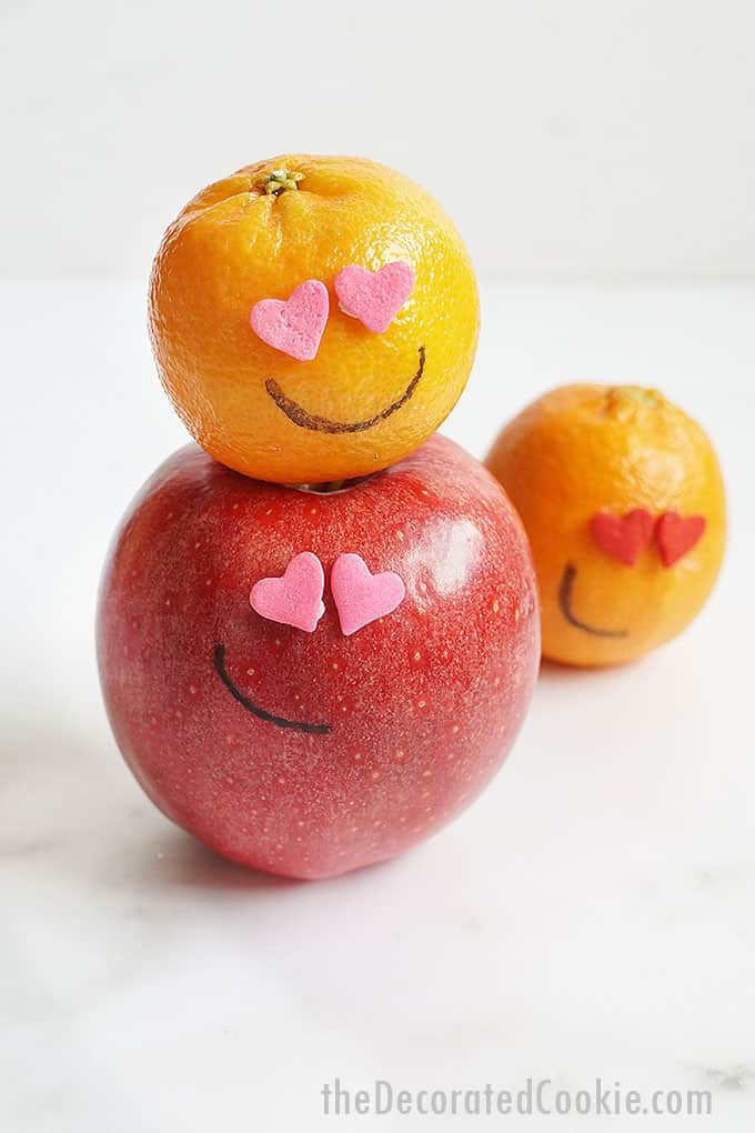 apples and oranges with heart sprinkle eyes for Valentine's Day