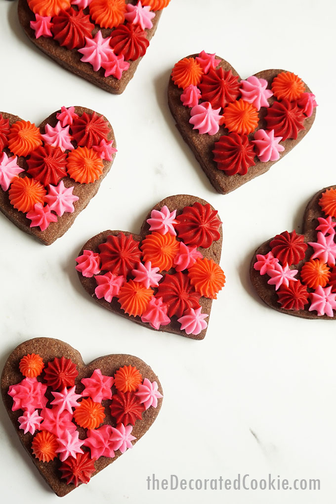 overhead image of Valentine's Day chocolate cookie hearts with frosting