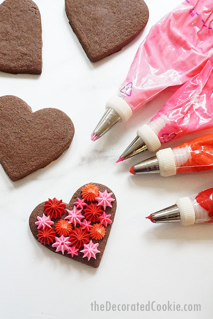 red and pink frosting bags with chocolate heart cookies