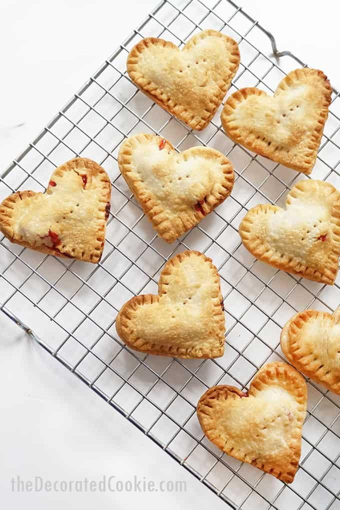 Valentine's Day nutella strawberry hand pies on wire rack