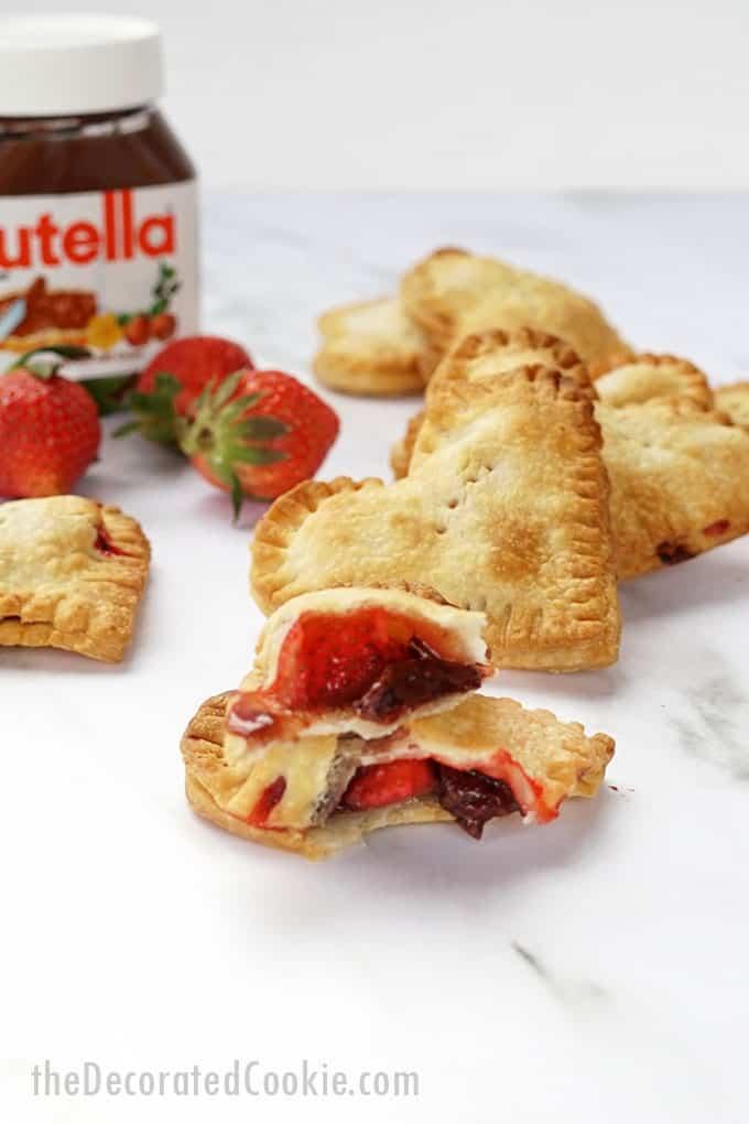 close up of broken Valentine's Day nutella strawberry hand pies.