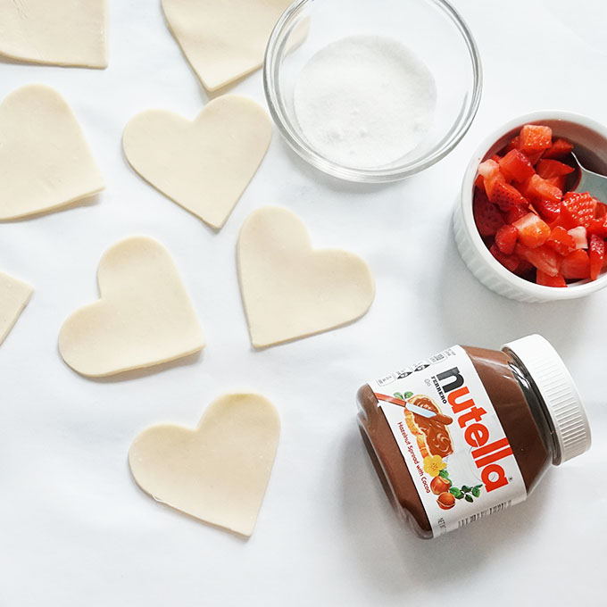 assembling hearts from pizza dough for valentine's day hand pies