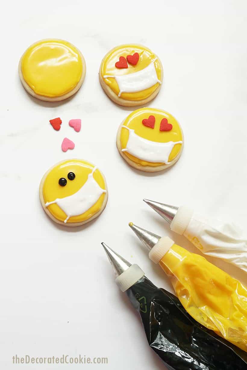 icing bags and mask emoji cookies