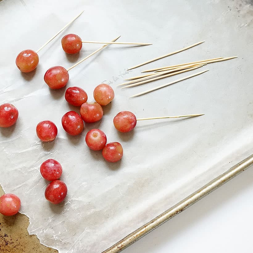 skewering grapes with toothpicks